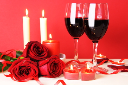 candles, wine glasses and roses