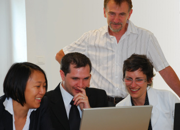 employees laughing at computer