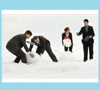 business people playing in the snow