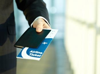 businessman with airline ticket