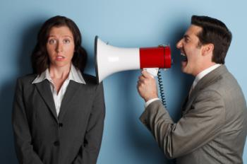 boss speaking through megaphone to employee