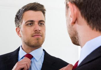 businessman looking in mirror