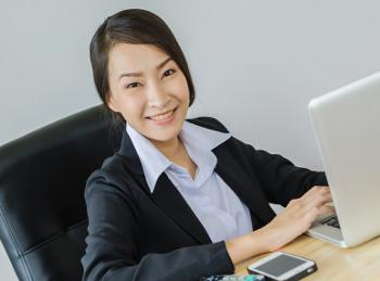 confident business woman on computer
