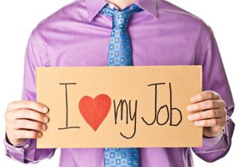 businessman holding I love my job sign