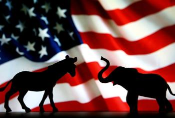 American flag with Republican and Democrat mascots