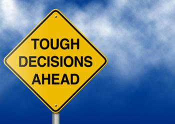 tough decisions ahead sign