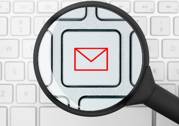 magnifying glass and email