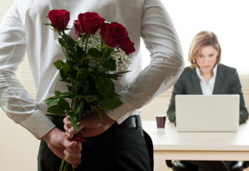 business woman receiving roses