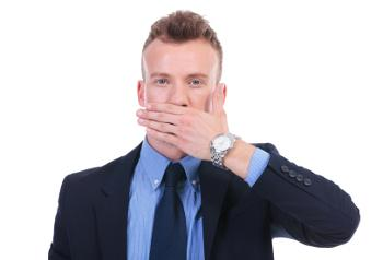 business man with hand covering mouth