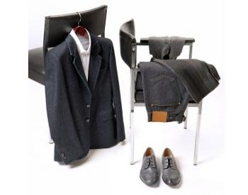 suit and casual clothing hanging on chair