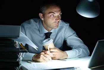 man working late